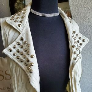 White leather studded vest.